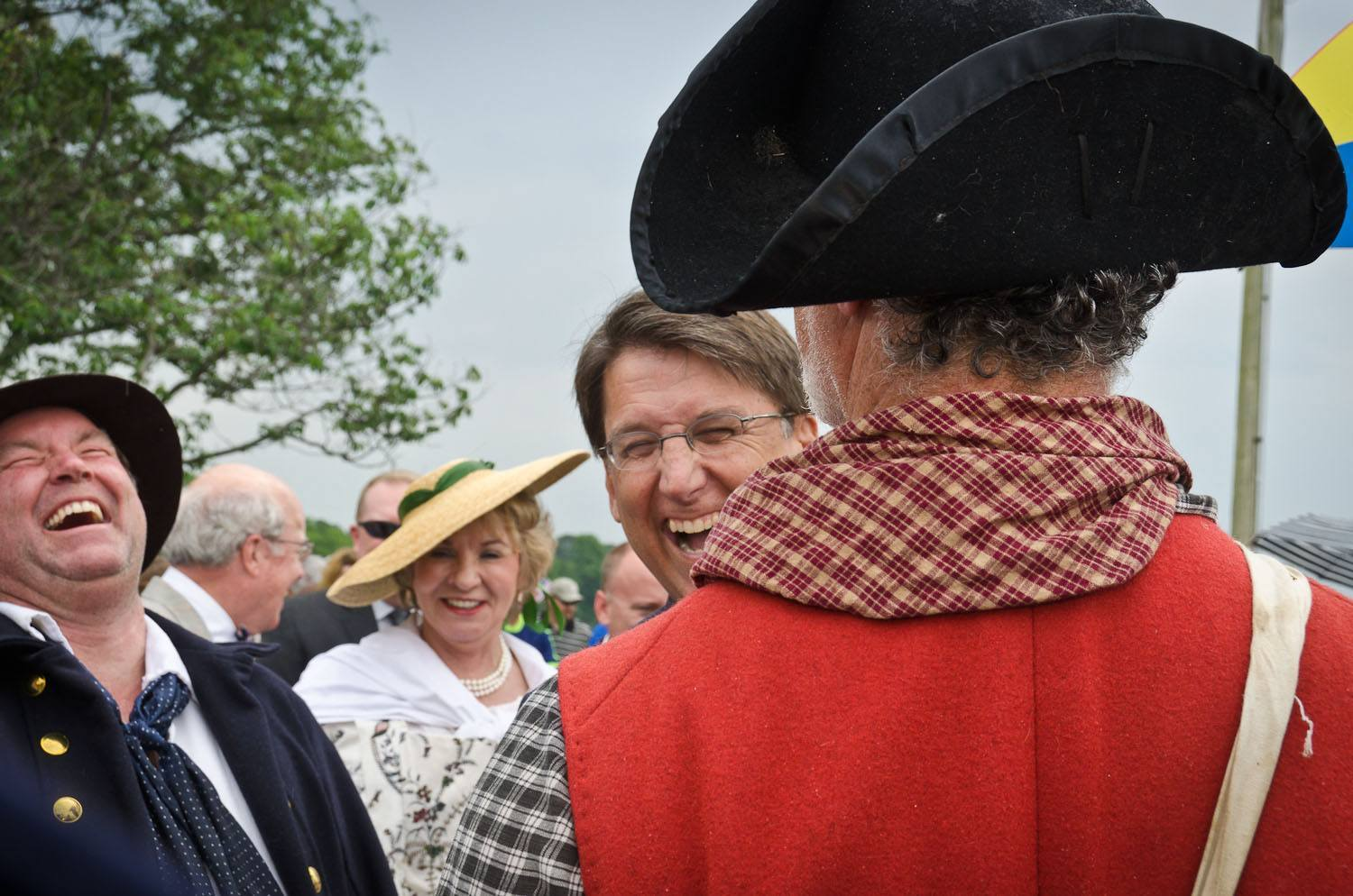 Gov McCrory shares a laugh with attendees in colonial garb.