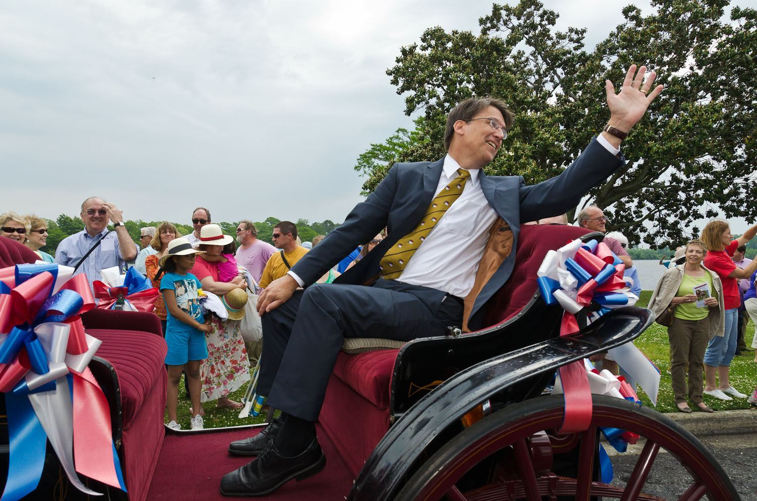 Gov McCrory in his horse-drawn carriage waves to the crowd