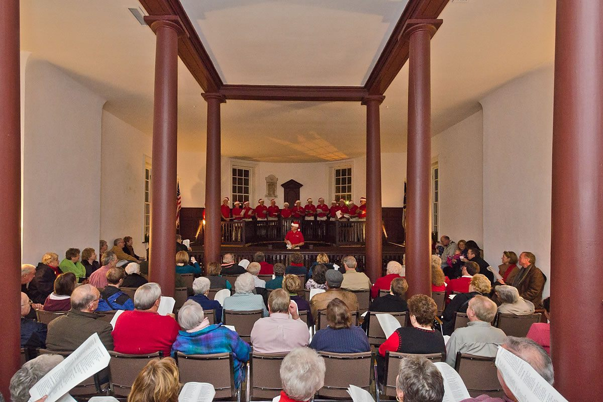 Community caroling in the Colonial Courthouse, Edenton, North Carolina (Photo by Kip Shaw)